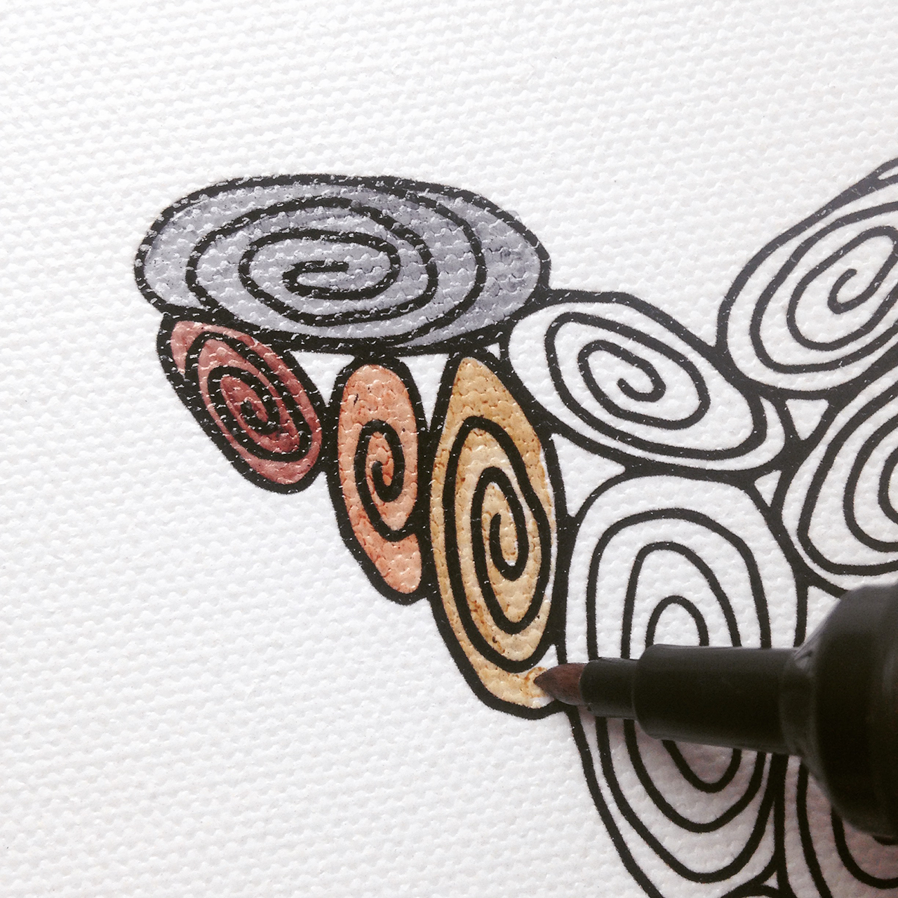 A pen coloring in a swirl on the Marin 100 Swirl Creative Progress Map from the Creature Collection